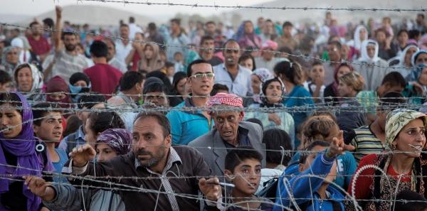 Al  nuevo gobierno español: Un gran pacto estatal de integración de los refugiados